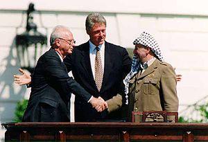 Bill_Clinton,_Yitzhak_Rabin,_Yasser_Arafat_at_the_White_House_1993-09-13