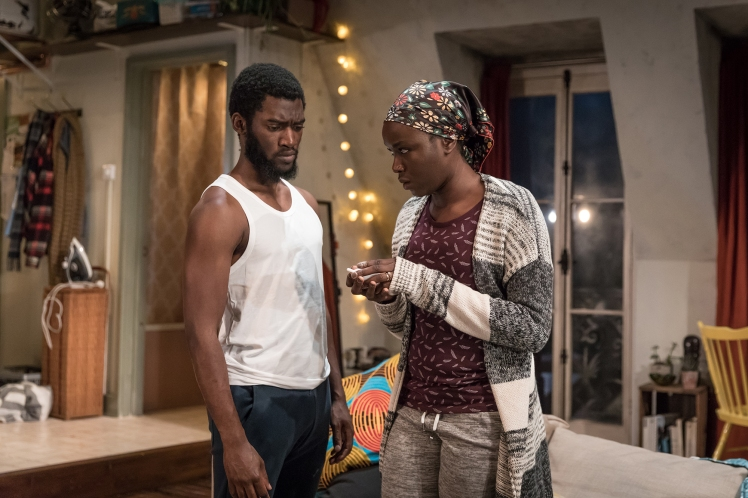 Malachi Kirby (Alioune) & Faith Alabi (Amina) in Belleville at the Donmar, directed by Michael Longhurst, designed by Tom Scutt. Photo by Marc Brenner