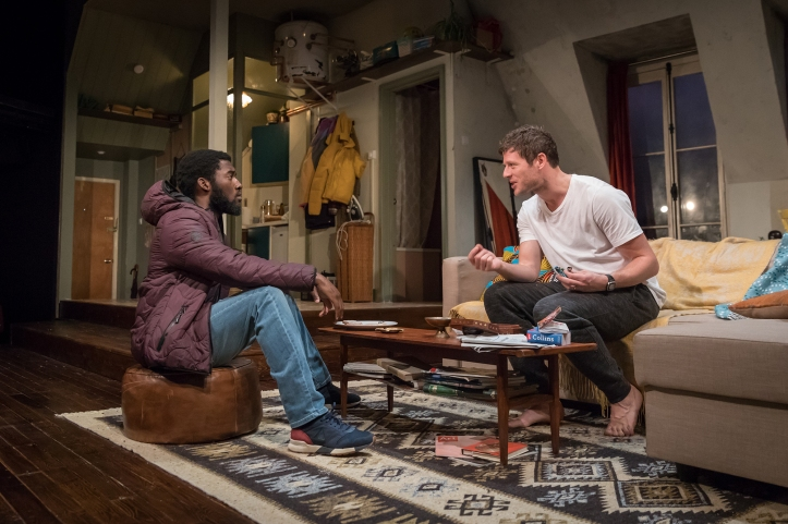 Malachi Kirby (Alioune) & James Norton (Zack) in Belleville at the Donmar, directed by Michael Longhurst, designed by Tom Scutt. Photo by Marc Brenner